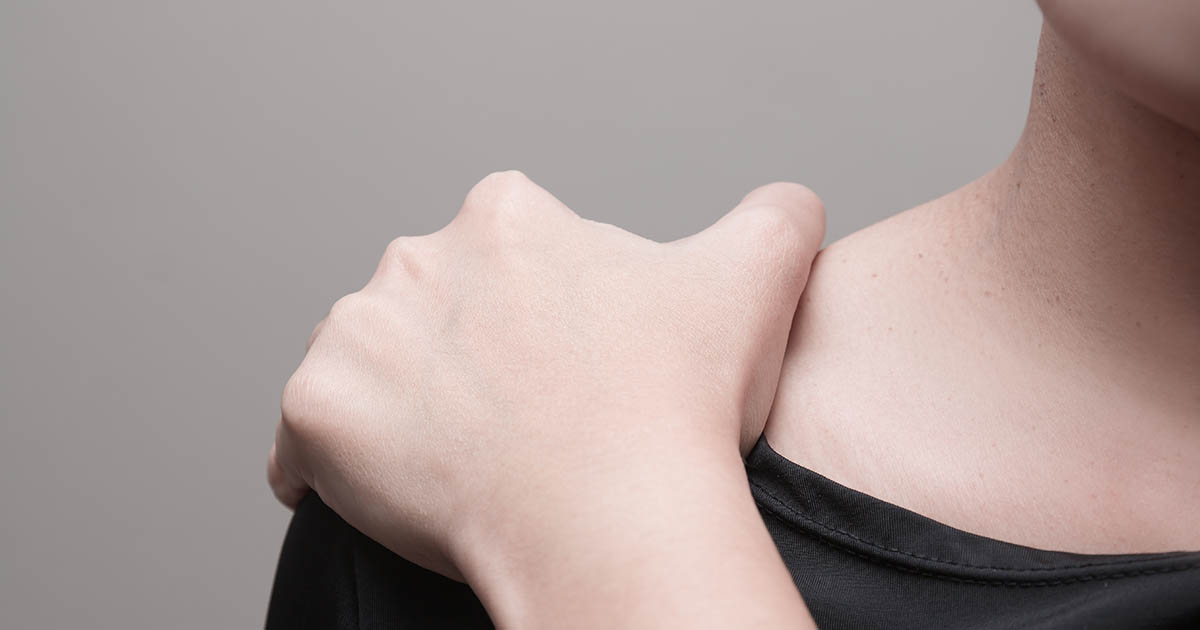 Woman suffering from pain in shoulder