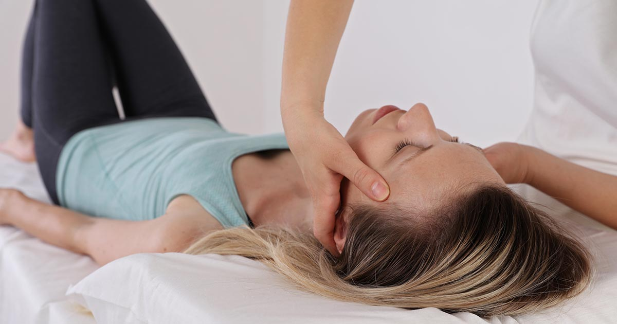 Woman receiving acupressure treatment