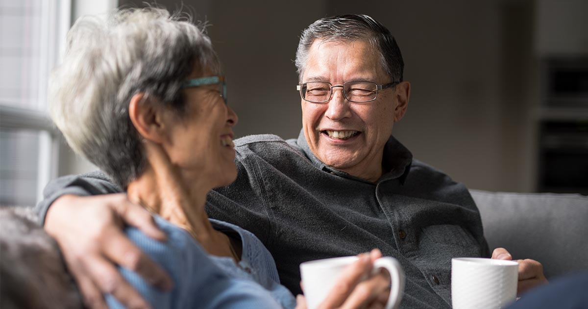 Couple enjoy a cup of coffee together in the morning