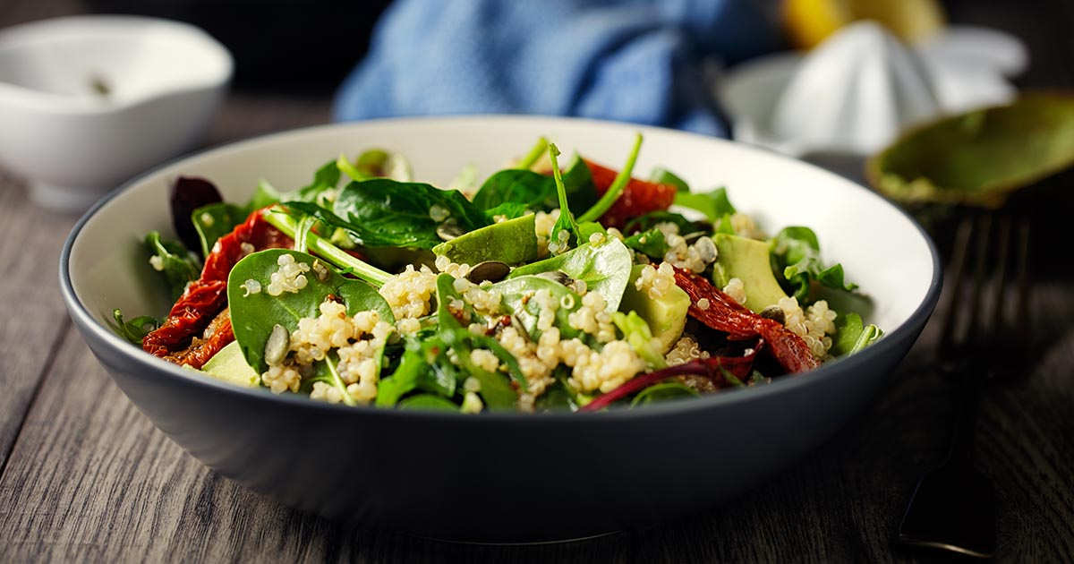Healthy vegan quinoa spinach salad