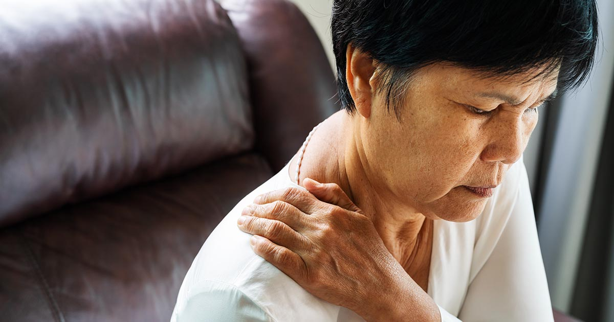 Old woman suffering from neck and shoulder pain