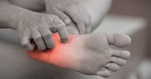 Person experiencing heel pain