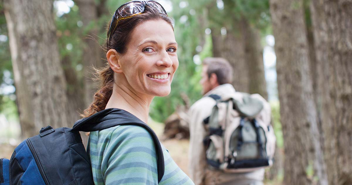 Woman outside trail hiking