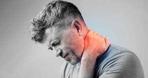 Man is experiencing neck muscle pain
